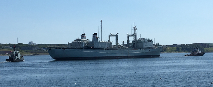 The HMCS Preserver is towed to the Sydport Industrial Park in Sydney Nova Scotia by Marine Recycling Corporation.